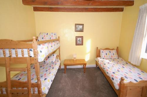 First floor bedroom, bunk and bed